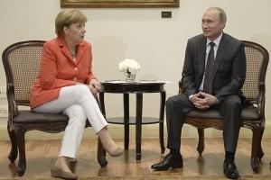 Russian President Putin meets with German Chancellor Merkel in Rio de Janeiro