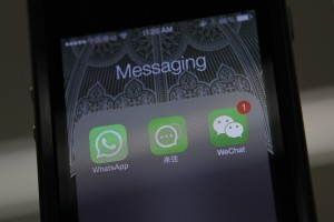 Icons of messaging applications WhatsApp, Laiwang and WeChat, or Weixin, are seen on the screen of a smart phone on this photo illustration taken in Beijing