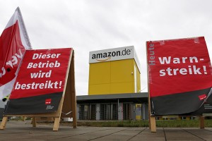 Verdi union placards reading 'Warning strike' are placed in front of Amazon logistics centre in Graben