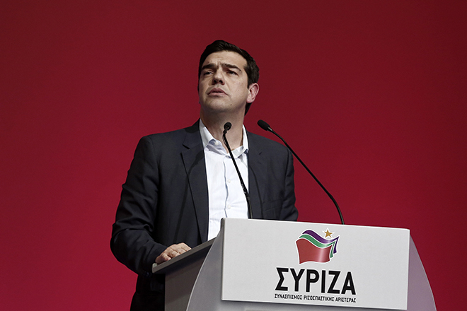Alexis Tsipras, opposition leader and head of radical leftist Syriza party, looks on as he speaks during a party congress in Athens