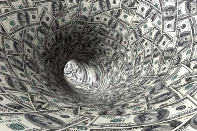 Ένας κόσμος πνιγμένος στο χρέος