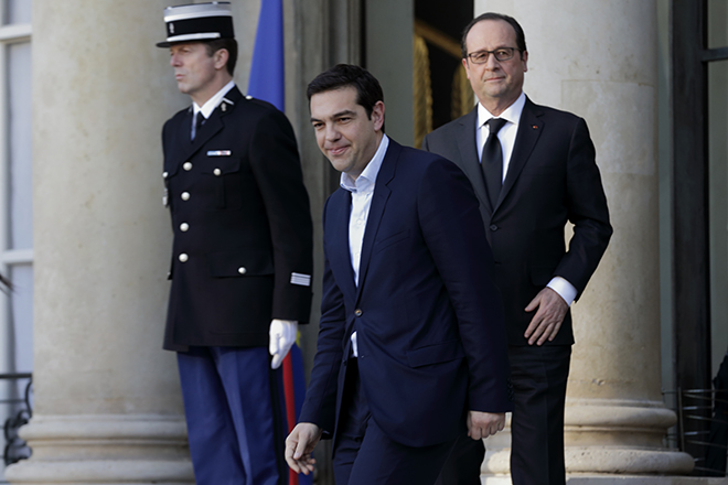 French President Hollande accompanies Greek Prime Minister Tsipras as he leaves the Elysee Palace in Paris