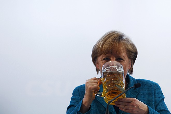 German Chancellor and head of the CDU Merkel drinks a beer after her speech in a beer tent in Munich