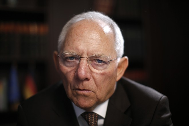 German Finance Minister Schaeuble leaves his office after taking part in Reuters Euro Zone Summit in Berlin