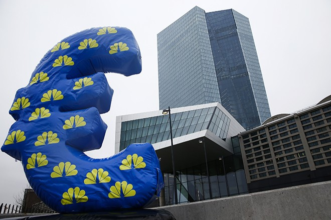 Inflated euro sign is seen outside the new headquarters of the European Central Bank (ECB) in Frankfurt