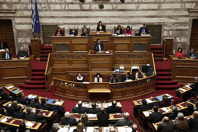 Greek PM Tsipras addresses lawmakers during a parliamentary session before a vote of confidence in Athens