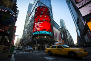 Signage for Sabre Corporation is seen at the NASDAQ MarketSite in Times Square in celebration of its initial public offering (IPO) on the NASDAQ Stock Market in New York