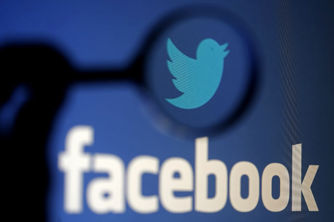 A logo of Twitter is pictured next to the logo of Facebook in this illustration photo in Sarajevo