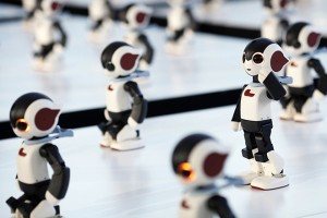Humanoid communication robots called Robi call their numbers before a dance performance dance during a promotional event called 100 Robi, for the Weekly Robi Magazine, in Tokyo