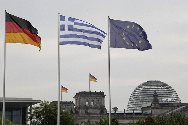 The flags of Germany, Greece and European Union flutter in the wind in Berlin