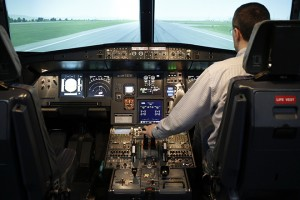 Lueck, CEO of ViennaFlight, sits in the cockpit of an Airbus A320 flight simulator in Vienna
