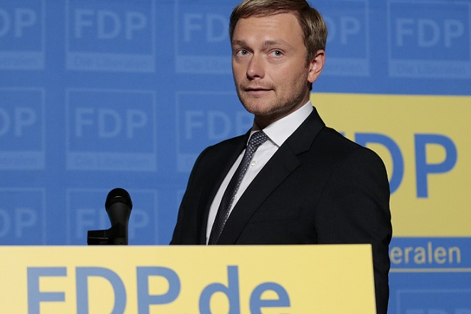 Lindner of the liberal Free Democratic Party (FDP) arrives for a news conference after a presidium meeting in Berlin