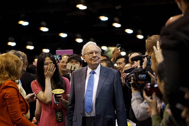 Berkshire Hathaway CEO Warren Buffett reacts after throwing in a newspaper throwing contest prior to the Berkshire annual meeting in Omaha
