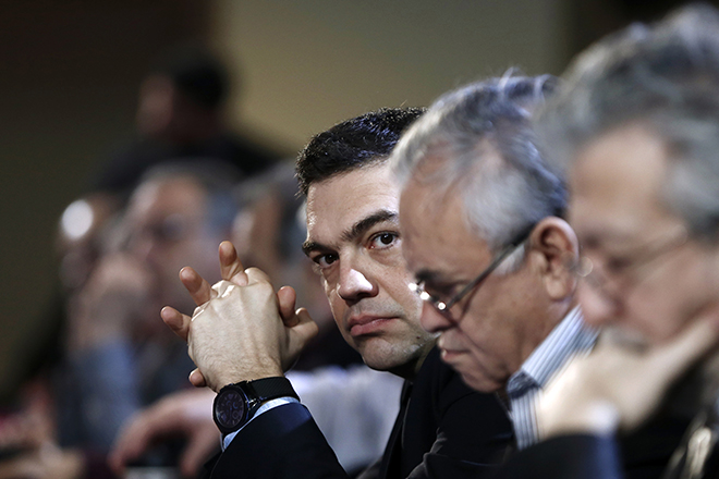 Greek PM Tsipras looks on before his speech at the ruling Syriza party central committee in Athens