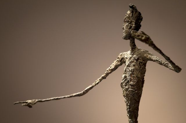 """The top half of Alberto Giacometti's """"L'homme Au Doigt"""" (Pointing man) sculpture is pictured at Christie's Auction House in the Manhattan borough of New York"""