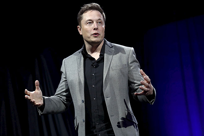 Tesla Motors CEO Elon Musk reveals the Tesla Energy Powerwall Home Battery during an event in Hawthorne, California