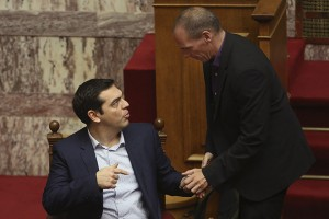 Greek Finance minister Yanis Varoufakis talks with Greek PM Tsipras in the Greek parliament in Athens