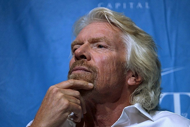 Sir Richard Branson, founder of Virgin Group, waits to speak on a panel at the annual Skybridge Alternatives Conference (SALT) in Las Vegas May 7, 2015.  REUTERS/Rick Wilking  - RTX1C0WQ
