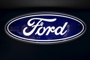 The corporate logo of Ford is seen at a Ford branch in Caracas March 27, 2015. The Venezuela division of Ford Motor Company in the coming months will begin selling vehicles only in dollars, two sources familiar with the situation said on Friday, as currency controls leave the automaker unable to recover revenue from local sales. A lack of parts for assembly in April led Ford de Venezuela to halt assembly as it was unable to obtain dollars for import through the currency controls system, which has also left it unable to turn local bolivar currency into greenbacks. Picture taken on March 27, 2015. REUTERS/Carlos Garcia Rawlins - RTX1C5FW