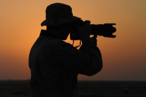 U.S. Air Force Airman 1st Class Jonathan Snyder, of 407th Air Expeditionary Group Public Affairs, captures photographs of flight line operations on Ali Air Base, Iraq, Oct. 3, 2007.  (U.S. Air Force photo by Master Sgt. Rob Wieland) (Released)