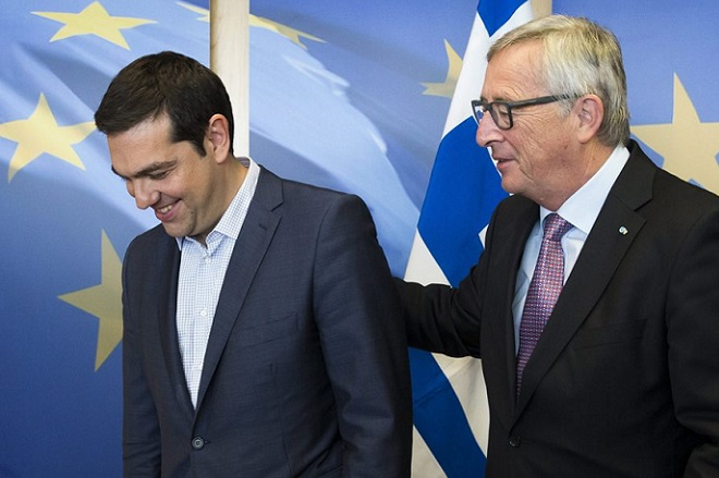 epa04816490 Greece's Prime Minister Alexis Tsipras (L) is welcomed by European Commission President Jean-Claude Juncker (R) ahead of a meeting on Greece, at the European Commission in Brussels, Belgium, 24 June 2015. Greek Prime Minister Alexis Tsipras is set to conduct yet another round of crisis talks with representatives of the country's creditors, ahead of a crucial meeting of eurozone finance ministers where all sides hope a solution can be found to save the country from bankruptcy.  EPA/JULIEN WARNAND