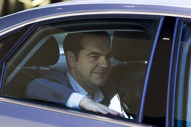 Greek Prime Minister Alexis Tsipras leaves the European Commission headquarters after a meeting with the European Commission, the International Monetary Fund (IMF), the European Central Bank (ECB) and the bloc's rescue fund in Brussels, Belgium June 24, 2015. Tsipras wrestled with creditors demanding changes to his proposed tax and reform plans on Wednesday in a last-minute race to clinch a deal to which euro zone finance ministers could agree. REUTERS/Yves Herman  - RTR4YSR7