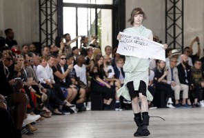 epaselect epa04818101 A model holds a fabric reading 'Please kill Angela Merkel not' as he presents a creation from the Spring/Summer 2016 Menswear collection by US designer Rick Owens during the Paris Men's Fashion Week, in Paris, France, 25 June 2015. The presentation of the Men's collections runs from 24 to 28 June.  EPA/GUILLAUME HORCAJUELO