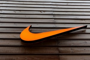 """The logo of Nike is seen in a storefront in Sao Paulo May 28, 2015. Nike, which is not a FIFA partner but is challenging Adidas' dominance in soccer by sponsoring many of the world's top players and teams, said it was cooperating with authorities after it was indirectly identified in the U.S. indictment in relation to a 1996 deal with the Brazil team. Nike later said in a statement it was """"concerned by the very serious allegations, adding: """"Nike believes in ethical and fair play in both business and sport and strongly opposes any form of manipulation or bribery."""" REUTERS/Paulo Whitaker - RTX1EZ98"""