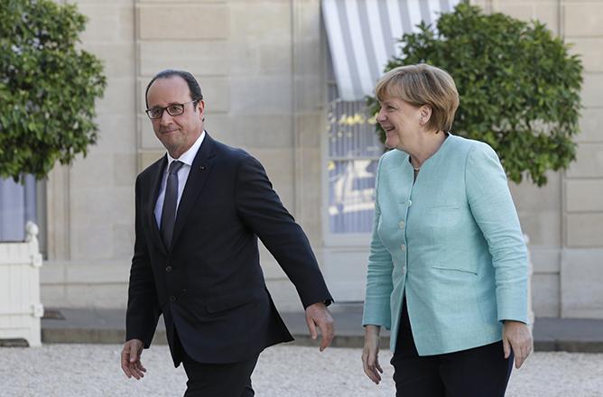 Μέρκελ – Ολάντ: Συνάντηση κορυφής σε κλίμα αβεβαιότητας