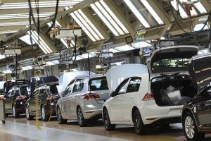 Volkswagen Golf VII cars are pictured in a production line at the plant of German carmaker Volkswagen in Wolfsburg, March 3, 2015.  Volkswagen will announce their results at their annual balance news conference on March 12 in Berlin. Picture taken March 3, 2015.  REUTERS/Fabian Bimmer (GERMANY - Tags: BUSINESS TRANSPORT SCIENCE TECHNOLOGY)