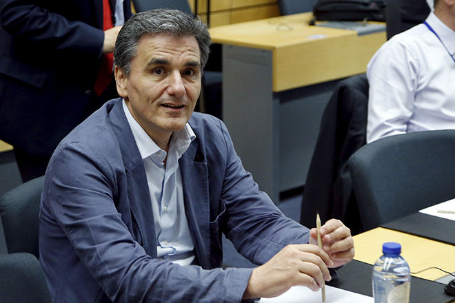 Greek Finance Minister Euclid Tsakalotos waits for the start of an euro zone finance ministers meeting in Brussels, Belgium, July 11, 2015. Greek Prime Minister Alexis Tsipras won backing from lawmakers on Saturday for painful reforms but it remained unclear whether it would be enough to secure a bailout from German and other euro zone ministers meeting in Brussels. REUTERS/Francois Lenoir - RTX1K00A