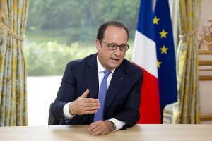 French President Francois Hollande speaks during the annual television interview at the Elysee Palace following the Bastille Day military parade in Paris, France, July 14, 2015. REUTERS/Alain Jocard/Pool - RTX1K9Z9