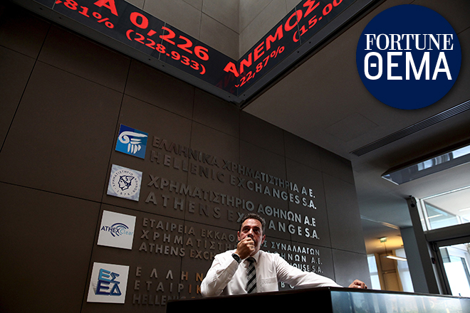 An employee looks on at electronic board displaying stock prices at the entrance of the Athens Stock Exchange, Greece, August 3, 2015. Greece's stock market plunged nearly 23 percent on Monday when it opened after a five-week shutdown brought on by fears the country was about to be dumped from the euro zone. REUTERS/Yiannis Kourtoglou - RTX1MTEN