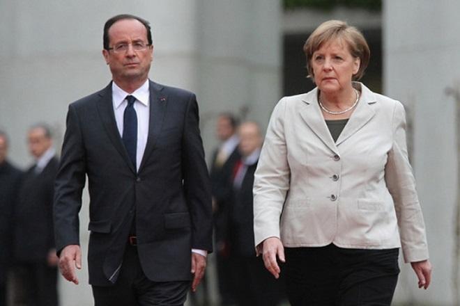 Μέρκελ-Ολάντ: Δεν απειλείται η παγκόσμια οικονομία από τη «βουτιά» των χρηματιστηρίων