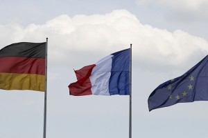 Flags of Germany, France and the European Union flutter in the wind before the meeting of new French President Francois Hollande and German Chancellor Angela Merkel in Berlin, May 15, 2012. Hollande called for a European pact for growth to balance out German-driven austerity measures in his inaugural address on Tuesday, hours before taking his challenge to Chancellor Angela Merkel in Berlin. Sworn in with all the pomp of the French Republic, Hollande won support from Germany's opposition Social Democrats (SPD), who vowed to use their parliamentary blocking power to delay ratifying a European budget discipline treaty until Merkel accepts accompanying measures to boost growth and jobs. REUTERS/Tobias Schwarz (GERMANY  - Tags: POLITICS)   - RTR323PQ