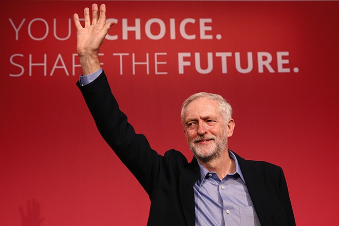The new leader of Britain's opposition Labour Party Jeremy Corbyn waves after making his inaugural speech at the Queen Elizabeth Centre in central London, September 12, 2015.  Avowed socialist and Karl Marx admirer Jeremy Corbyn was elected leader of Britain's opposition Labour party on Saturday, a result that may make a British EU exit more likely and which senior figures have said would leave their party unelectable. REUTERS/Stefan Wermuth  - RTSQTI