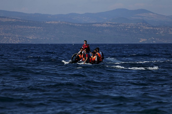 Afghan refugees arrive in a dinghy on the Greek island of Lesbos, September 12, 2015. Of the record total of 432,761 refugees and migrants making the perilous journey across the Mediterranean to Europe so far this year, an estimated 309,000 people had arrived by sea in Greece, the International Organization for Migration (IMO) said on Friday. About half of those crossing the Mediterranean are Syrians fleeing civil war, according to the United Nations refugee agency. REUTERS/Alkis Konstantinidis - RTSRNO