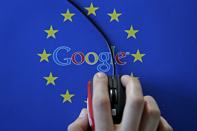 A woman hovers a mouse over the Google and European Union logos in Sarajevo, in this April 15, 2015 photo illustration. The European Union accused Google Inc on Wednesday of cheating competitors by distorting Internet search results in favour of its Google Shopping service and also launched an antitrust probe into its Android mobile operating system. REUTERS/Dado Ruvic - RTR4XG8S
