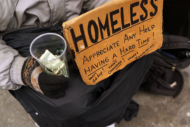 NEW YORK, NY - DECEMBER 04:  A person in economic difficulty holds a homemade sign asking for money along a Manhattan street on December 4, 2013 in New York City.  According to a recent study by the by the United States Department of Housing and Urban Development, New York City's homeless population increased by 13 percent at the beginning of this year. Despite an improving local economy, as of last January an estimated 64,060 homeless people were in shelters and on the street in New York. Only Los Angeles had a larger percentage increase than New York for large cities.  (Photo by Spencer Platt/Getty Images)
