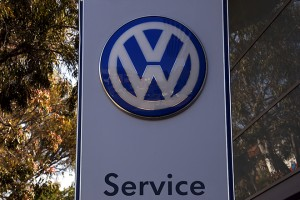"""A Volkswagen logo adorns a sign outside a dealership for the German automaker located in the Sydney suburb of Artarmon, Australia, October 3, 2015. Volkswagen said on Saturday it was suspending sales of some diesel vehicles in Australia that may have been fitted with devices designed to mask the level of emissions after meeting with authorities. Almost two weeks after confirming 11 million vehicles around the world had been fitted with so called """"defeat devices"""", the German automaker and subsidiary Audi have not provided details of the models or where they have been sold. REUTERS/David Gray - RTS2TOL"""