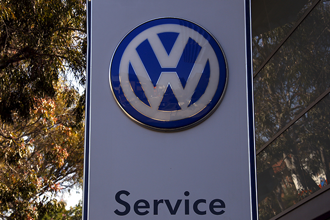 "A Volkswagen logo adorns a sign outside a dealership for the German automaker located in the Sydney suburb of Artarmon, Australia, October 3, 2015. Volkswagen said on Saturday it was suspending sales of some diesel vehicles in Australia that may have been fitted with devices designed to mask the level of emissions after meeting with authorities. Almost two weeks after confirming 11 million vehicles around the world had been fitted with so called ""defeat devices"", the German automaker and subsidiary Audi have not provided details of the models or where they have been sold. REUTERS/David Gray - RTS2TOL"
