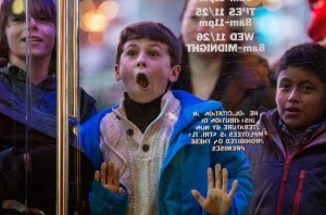 NEW YORK, NY - NOVEMBER 27:  A boy waits to enter the Toys R Us in Times Square on November 27, 2014 in New York, United States. Black Friday sales, which now begin on the Thursday of Thanksgiving, continue to draw shoppers out for deals and sales.  (Photo by Andrew Burton/Getty Images)