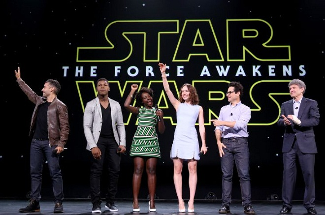 """ANAHEIM, CA - AUGUST 15:  (L-R) Actors Oscar Isaac, John Boyega, Lupita Nyong'o, Daisy Ridley, director J.J. Abrams of STAR WARS: THE FORCE AWAKENS and Chairman of the Walt Disney Studios Alan Horn took part today in """"Worlds, Galaxies, and Universes: Live Action at The Walt Disney Studios"""" presentation at Disney's D23 EXPO 2015 in Anaheim, Calif.  (Photo by Jesse Grant/Getty Images for Disney)"""