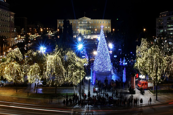 Athens' central Syntagma Square is lit up on Friday, Dec. 11, 2009, during the official inauguration of the Greek capital's Christmas celebrations. Police are on standby in the square for fear vandals might attack the city's main Christmas tree, which was burnt during rioting last year sparked by the fatal police shooting of a teenager. (AP Photo/ Thanassis Stavrakis)