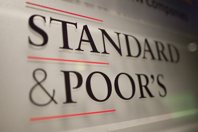 epa03333954 (FILE) A file photo dated 08 December 2011 shows a sign displaying the name of the Standard & Poor's financial rating services in its offices in Paris, France. Credit rating agency Standard & Poor's on 02 August 2012 renewed its top AAA ranking of Germany's long-term sovereign debt, due to the country's 'strong economic fundamentals.' In its statement Standard & Poor's said 'Germany has a highly diversified and competitive economy with a demonstrated ability to absorb large economic and financial shocks.'  EPA/IAN LANGSDON