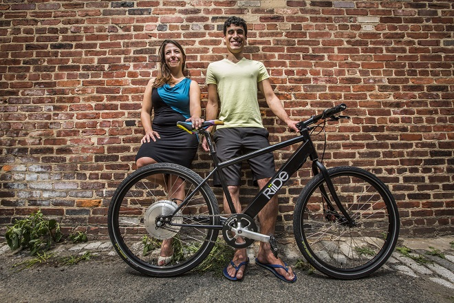 WASHINGTON, DC. JULY 29, 2014: Founders of Riide electric bike start-up, Amber Watson and Jeffrey Stefanis, in the alley outside their office / assembly space in a row house in Washington, DC. on July 29,2014 .( Photo by Jeffrey MacMillan )