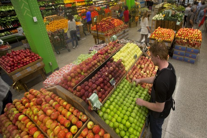TORONTO, ON - SEPTEMBER 26: For a story about the growth in premium food retailing, we visit a new Whole Foods store at Yonge and Sheppard in North York. Damien Bowmen tidies up in the Produce department.        (Keith Beaty/Toronto Star via Getty Images)