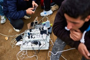 IDOMENI, GREECE - FEBRUARY 24: Refugees and migrants mostly from Syria charge their phones as they are stuck at the border with Macedonia as the border remained close since 9 am on February 24, 2016 in Idomeni, Greece. According to the local authorities 3000 to 3500 refugees and migrants wait to enter Macedonia to journey to Western Europe. Refugees from Afghanistan are not allowed to leave Greece and are turned back to Athens by bus. (Photo by Pierre Crom/Getty Images)