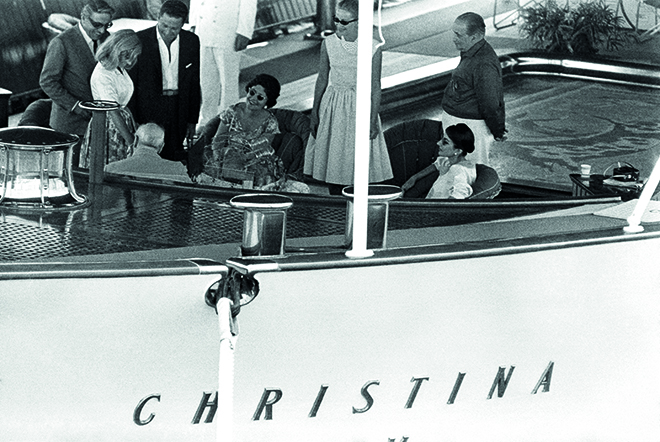 "Aristotle Onassis, Winston Churchill (back seated), Maria Callas and her husband Giovanni Battista Meneghini aboard ""Christina O"", yacht of the Greek shipping magnate Aristotle Onassis, in the port of Monaco (Principality of Monaco). In 1959. --- Image by © Georges Dudognon/Corbis"