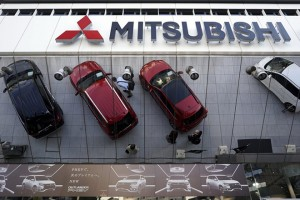 epa05269821 (FILE) A picture dated 27 October 2015 shows Mitsubishi vehicles reflected on a mirror at Mitsubishi Motors Corp.'s headquarters in Tokyo, Japan. On 21 April 2016, transport ministry officials inspected a plant of the carmaker in the central Japan following the revelation of a data falsification scandal.  EPA/FRANCK ROBICHON